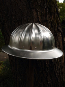Aluminum Hard Hat and Tree Trunk